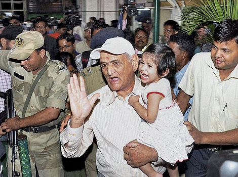 Dhoni's father