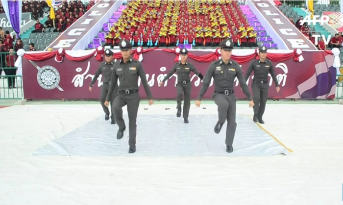 Police dancing at the thai armed forces fest