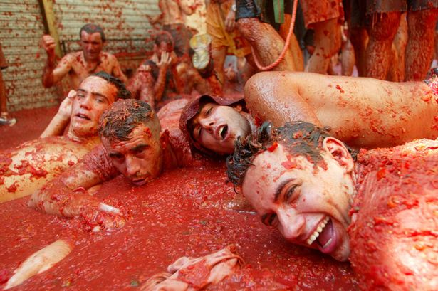 Revellers-lie-in-tomato-pulp
