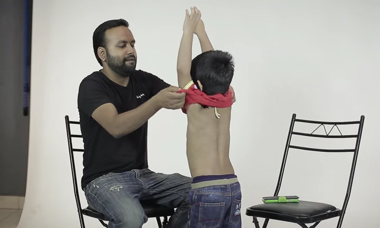 audition guy taking Abeer's t-shirt off