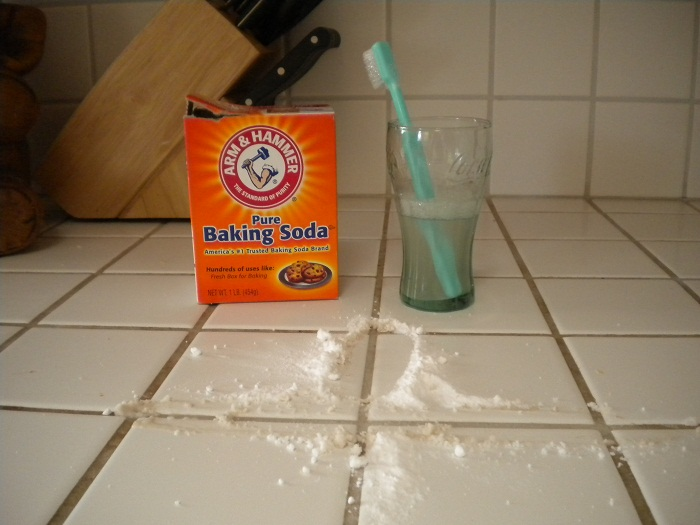 baking soda and tooth brush to clean kitchen tiles