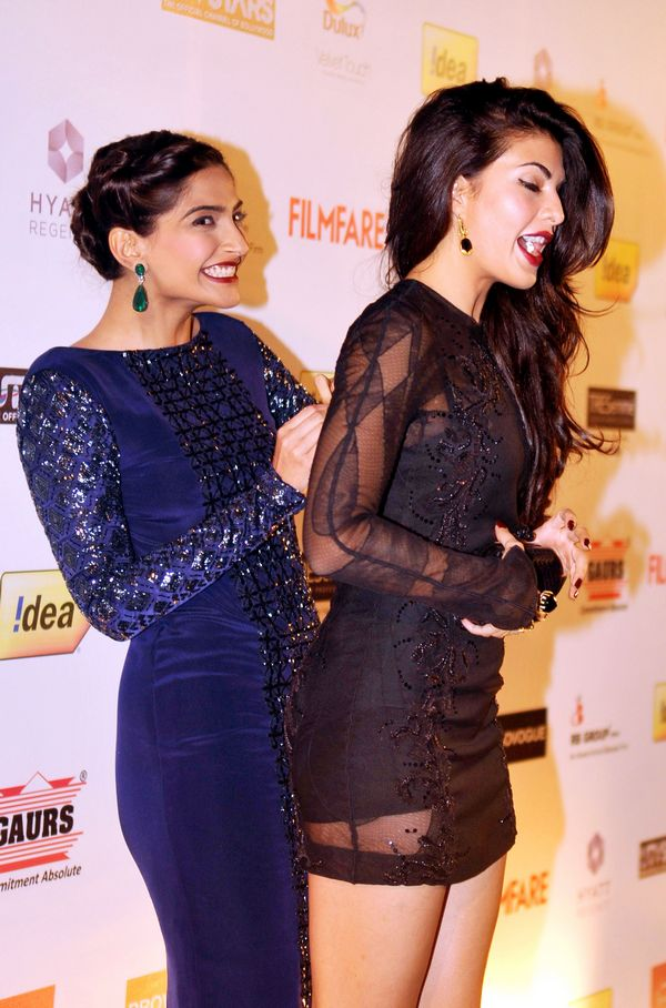 "Indian Bollywood actresses Sonam Kapoor (L) and Jacqueline Fernandez share a light moment while they pose for a photograph during the 59th ""Idea Filmfare Awards 2013"" pre-awards party in Mumbai on late January 15, 2014. AFP PHOTO/STR"
