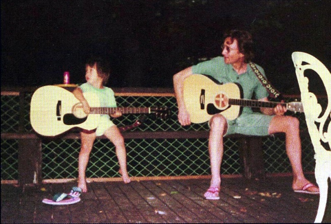 father like son playing guitar