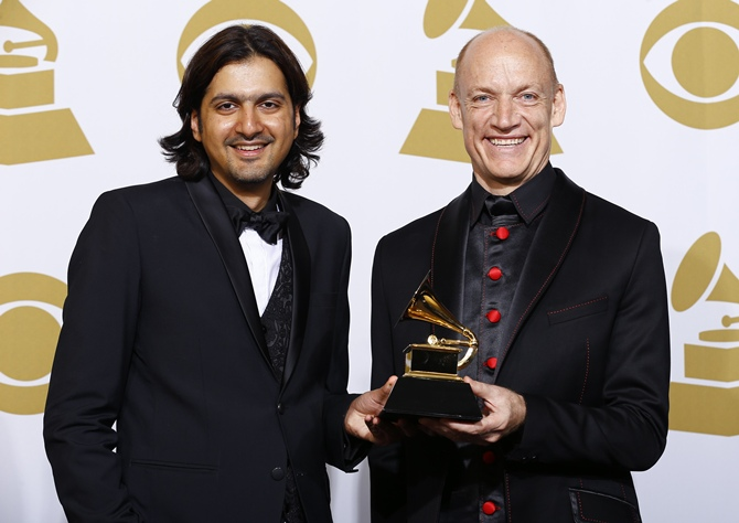 """Kej and Kellerman pose with the award for best new age album for """"Winds of Samsara"""" backstage at the 57th annual Grammy Awards in Los Angeles"""