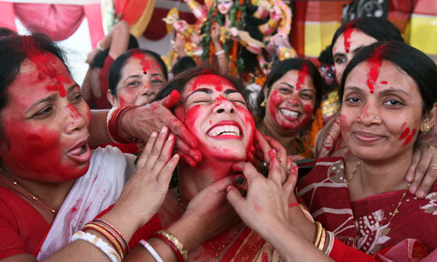 """A Hindu woman smeared with """"sindhur"""" on the last day of the Durga Puja festival in Chandigarh"""