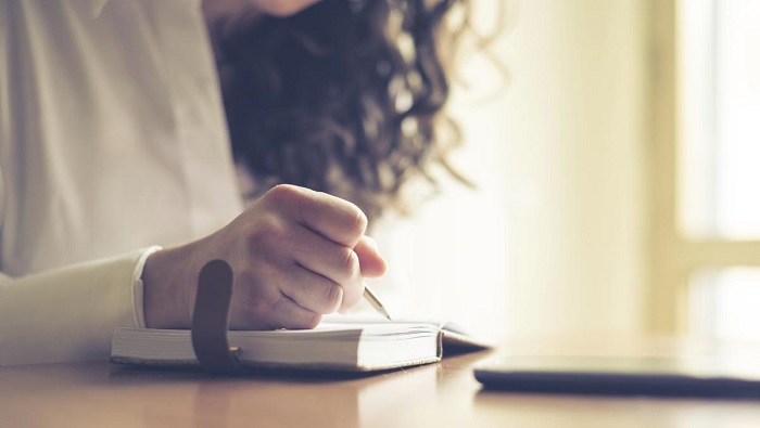 woman-writing-in-journal-