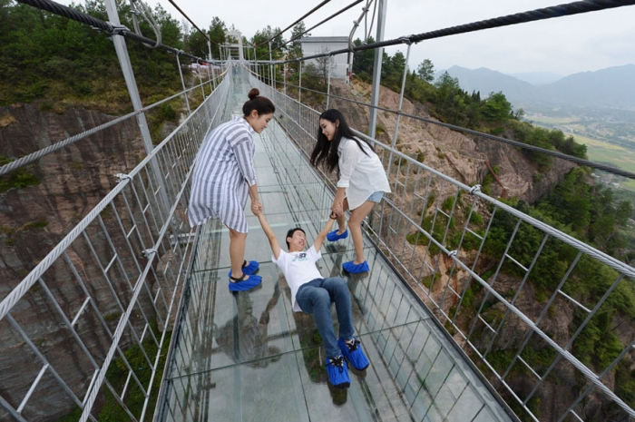 world 39 s scariest 590 feet high glass bridge in china costs
