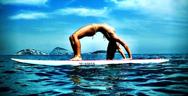 yoga on surfboard