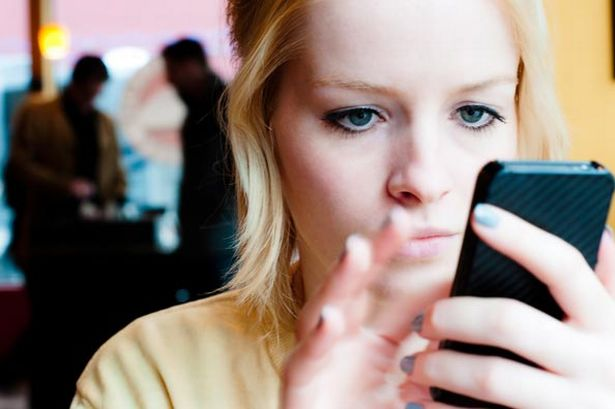 young-woman-using-a-mobile-phone-pic